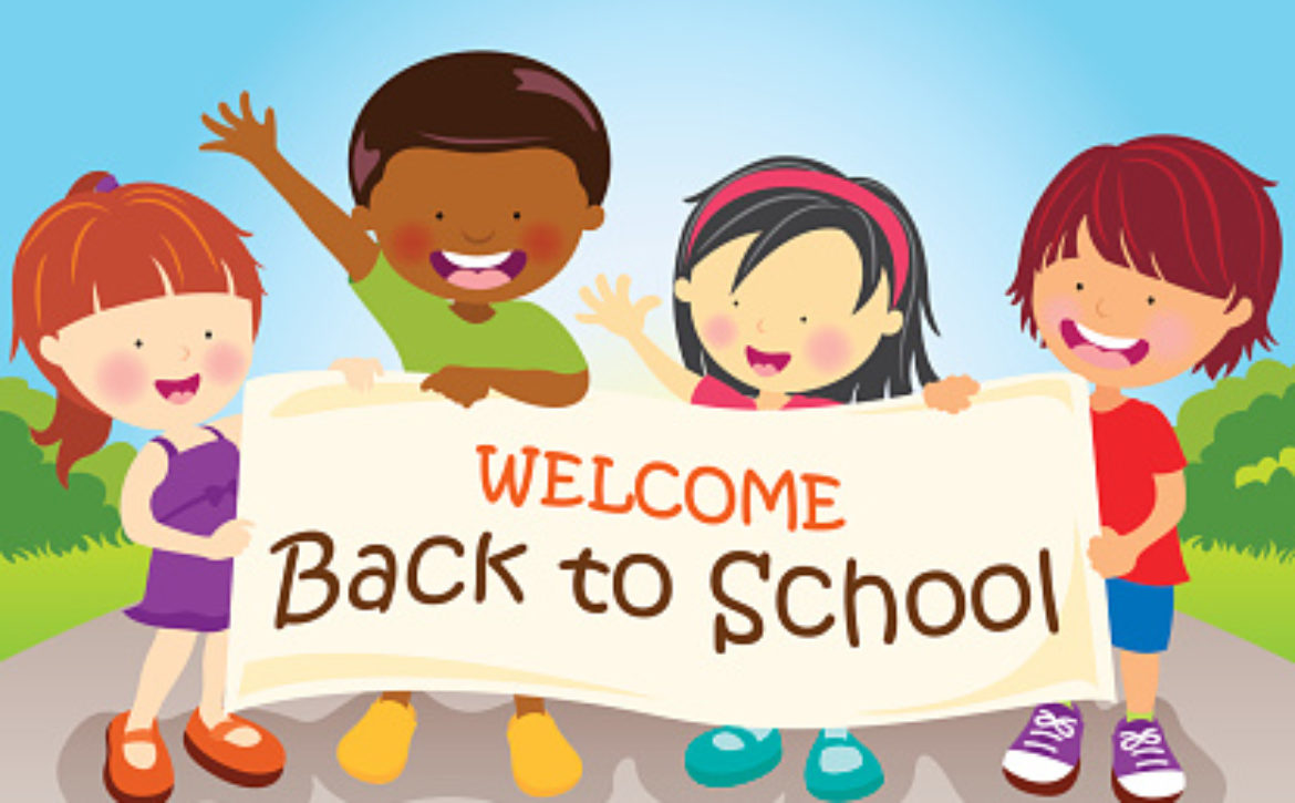 Multi-Ethnic kids holding banner to welcoming student back to school..